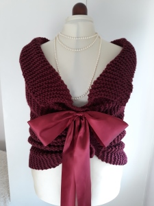 Knitted and crocheted wedding shrug with a bow